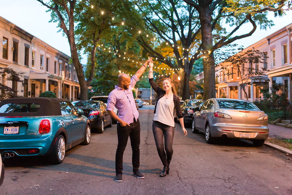 Dancing in the streets of DC during their night time engagement pictures