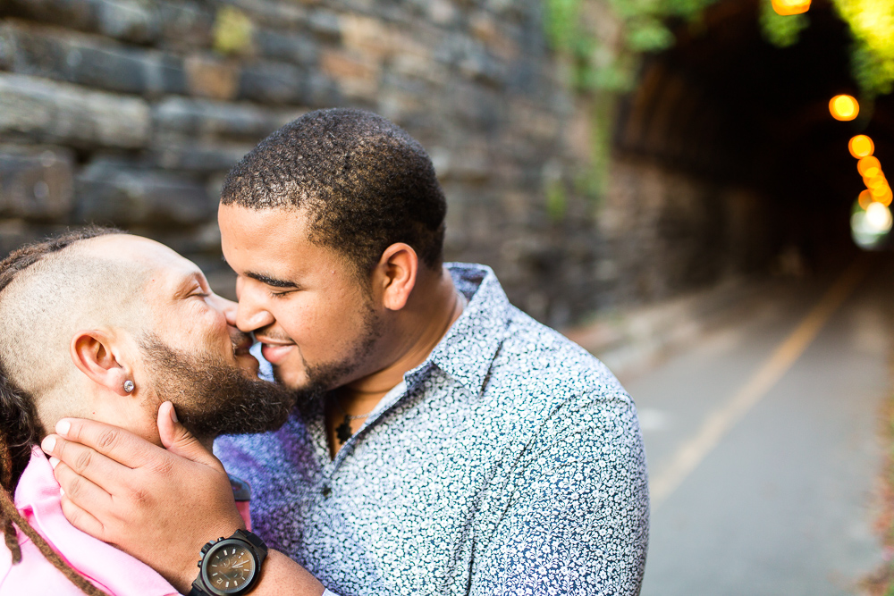 Same sex couple kisses near the Wilkes Street Tunnel in Old Town Alexandria | Gay wedding photographer in Northern Virginia