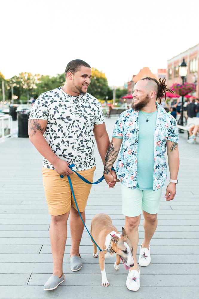 Walking their dog during engagement photos in Alexandria, Virginia