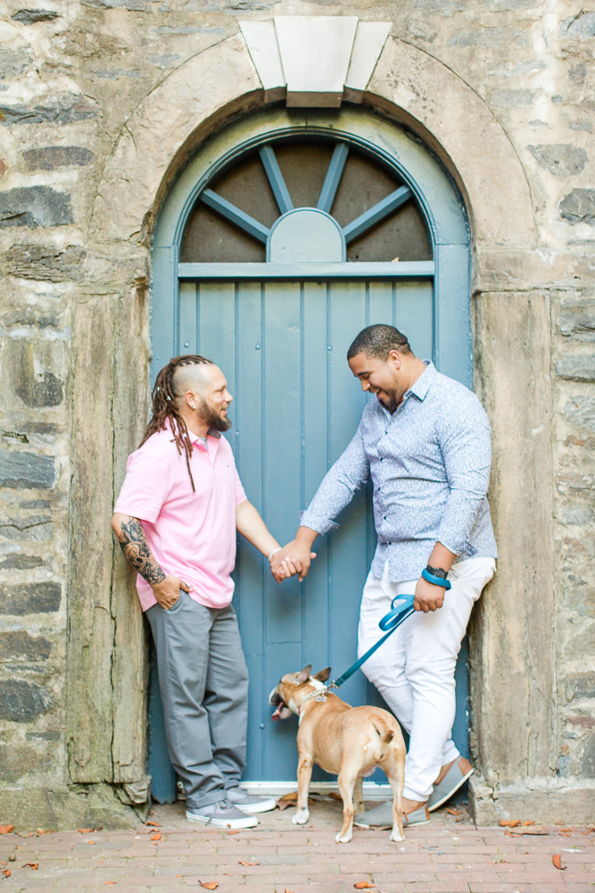 Holding hands near the blue door of Carlyle House in Alexandria, Virginia