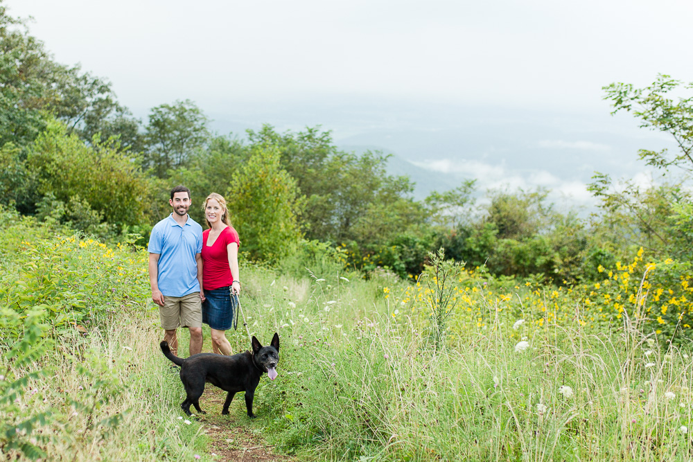 Outdoorsy engaged couple with their dog at an overlook on Skyline Drive
