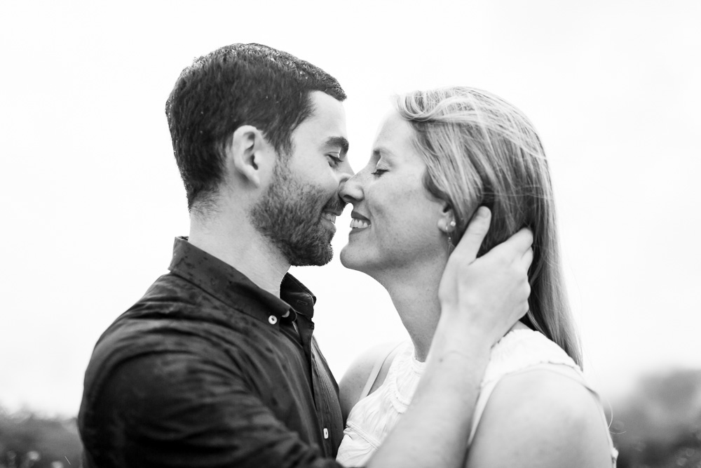 An engagement session kiss in the rain on Skyline Drive   Shenandoah National Park Photographer