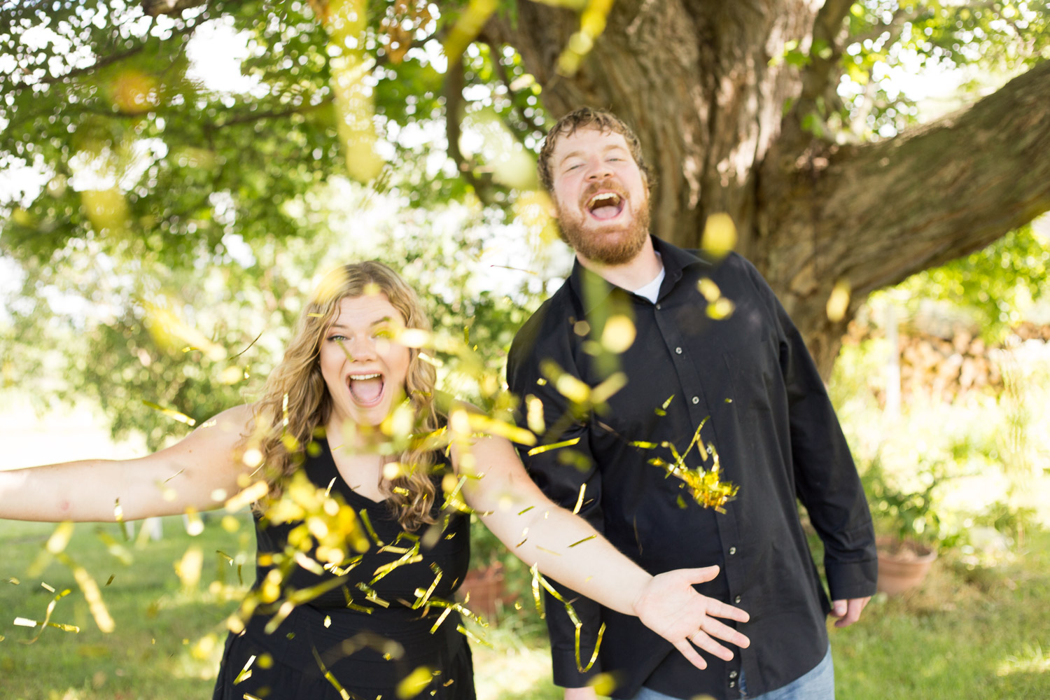 Engagement picture with gold confetti