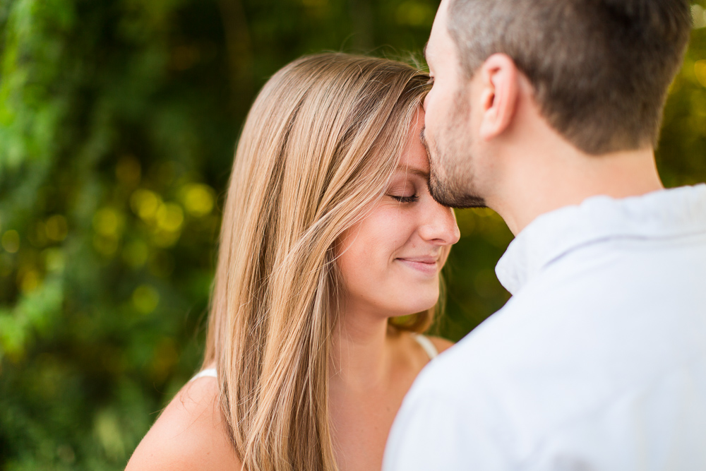 A kiss on the forehead during Richmond engagement photos