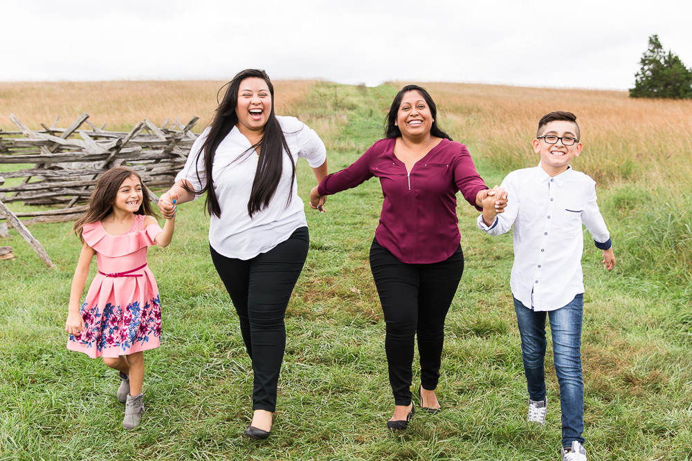 Candid picture with the kids running through Manassas Battlefield | LGBTQ photography, Northern Virginia
