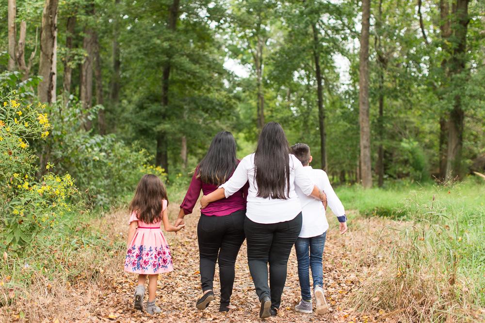 Happy family walking through the woods at Manassas Battlefield