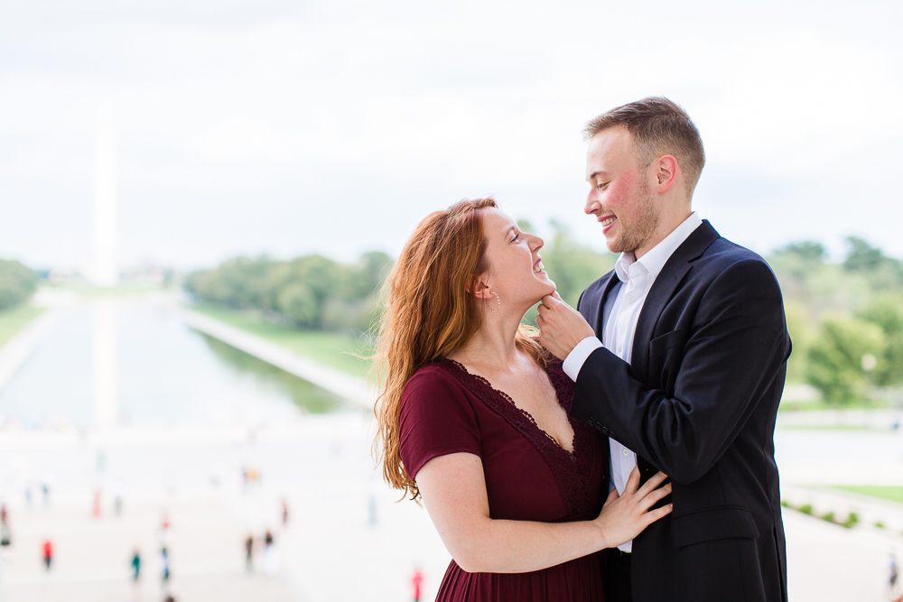 Engagement photo at the Lincoln with Reflecting Pool in the background