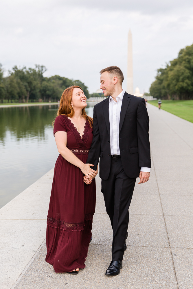 Sweet engaged couple walking along the Reflecting Pool | Megan Rei Photography