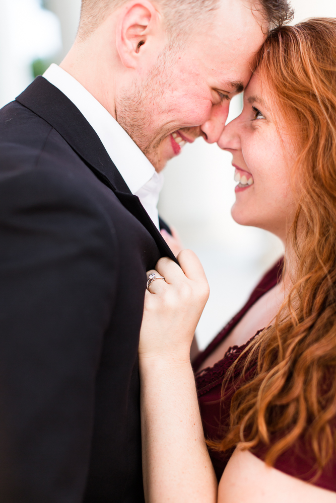 Smiling couple getting cuddly during their engagement session