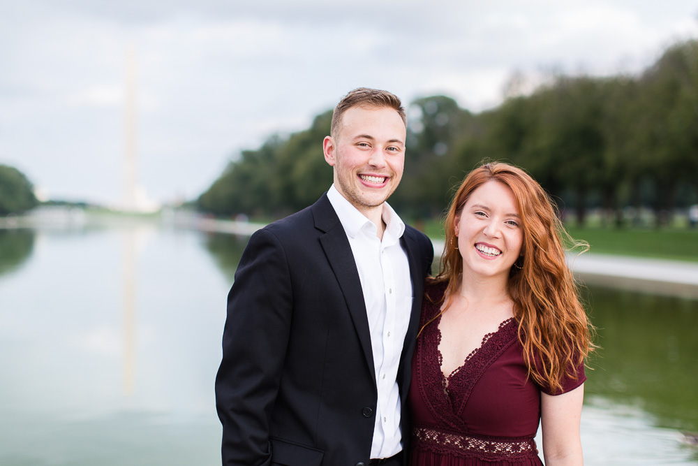 Smiling engaged couple during their engagement session at the monuments in DC | Megan Rei Photography