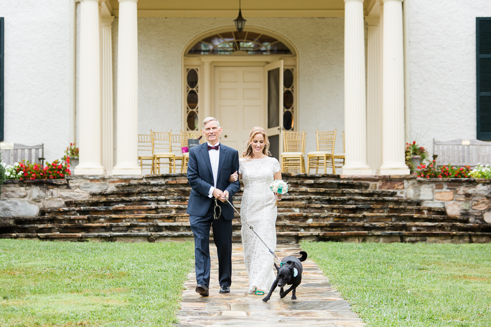 Bride and her dad walking down the aisle with her dog at Rust Manor House in Leesburg