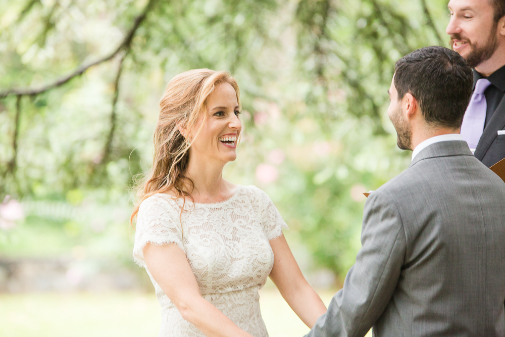 Candid photo of bride laughing during the ceremony | Candid Northern Virginia Photographer