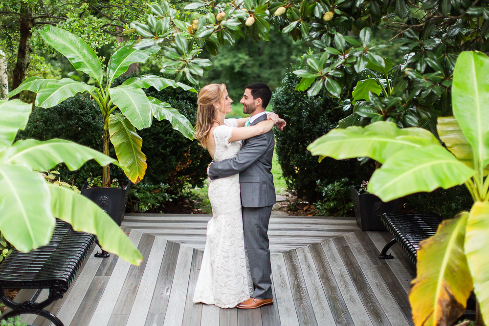 Happy couple surrounded by greenery on their eco-friendly wedding day