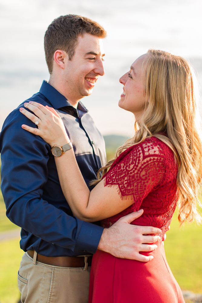 Smiling engaged couple at winery engagement session