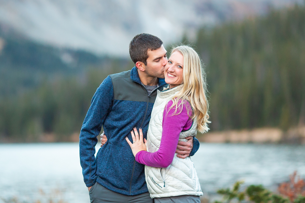 A kiss on the cheek at Long Lake, Ward, Colorado | Colorado Engagement Photo Locations