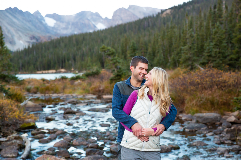 Candid engagement picture at Long Lake in the Brainard Lake Recreation Area | Denver Colorado Engagement Photographer