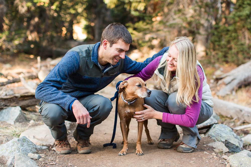 Couple showing some love to their adventure pup on the trail
