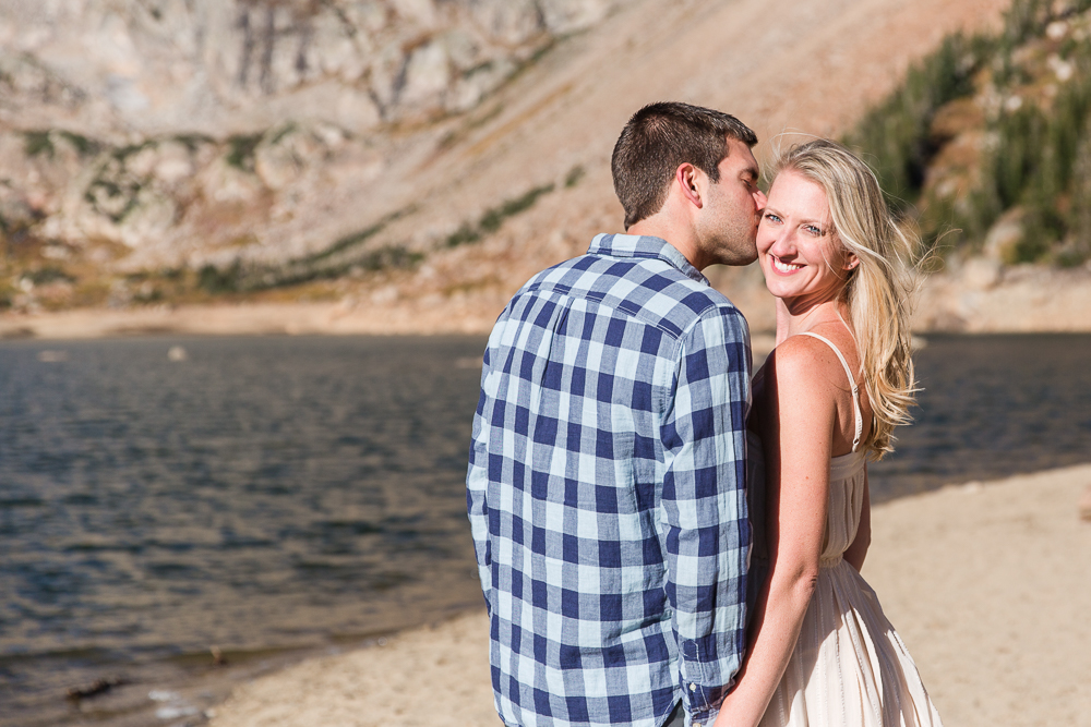 Giving his fiance a kiss during a sunny hike to Lake Isabelle