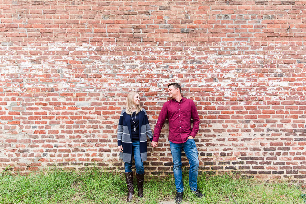 Posing against a brick wall in downtown Fredericksburg