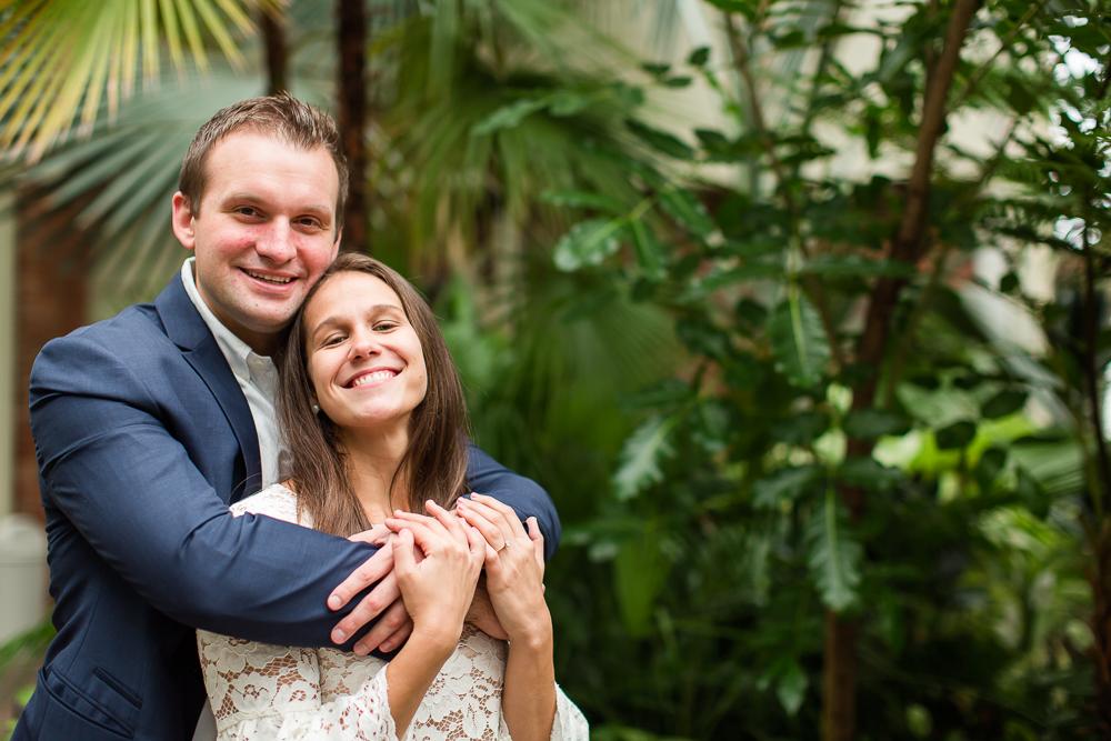 Happy engaged couple posing in Buffalo's Botanic Gardens