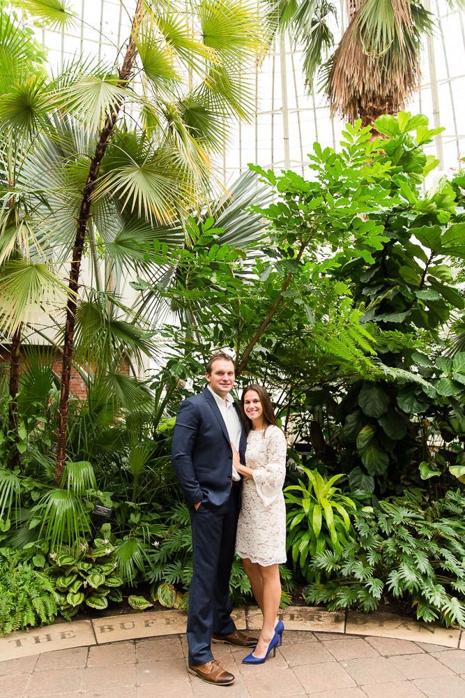 Engagement pictures in front of all the greenery