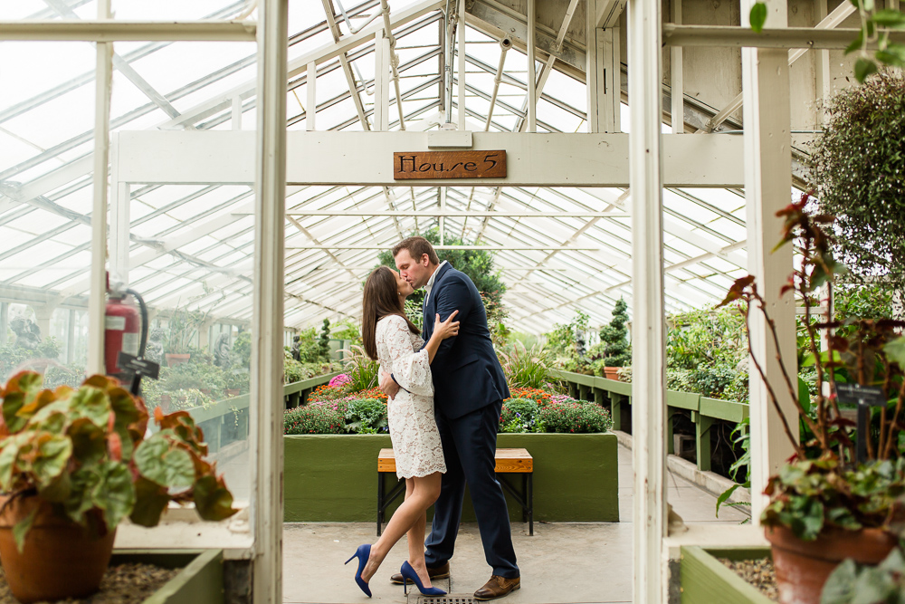 Engaged couple kissing in the greenhouse at the Buffalo Botanical Gardens wedding venue | Best Buffalo NY Engagement Locations