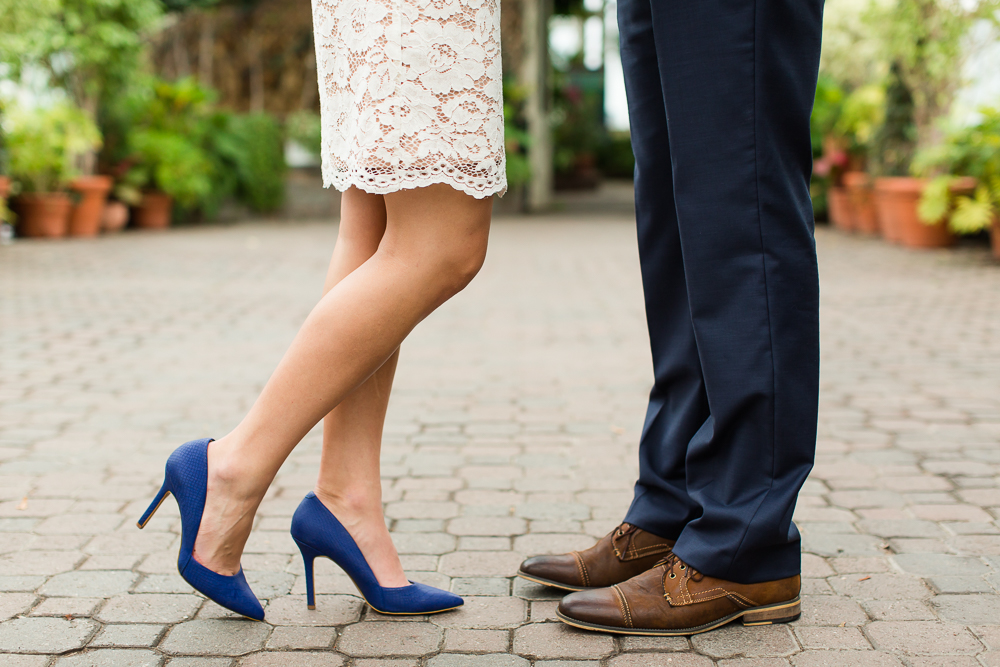 Best engagement photo outfits | White lace dress with blue heels and navy suit with brown shoes