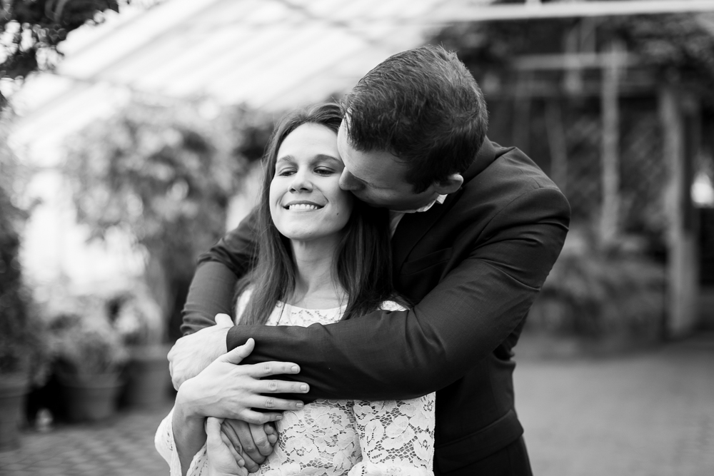 Romantic kiss on his fiance's cheek