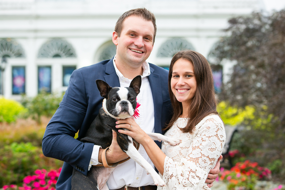 Engaged couple and their Boston Terrier all smiling for the camera during their engagement photos