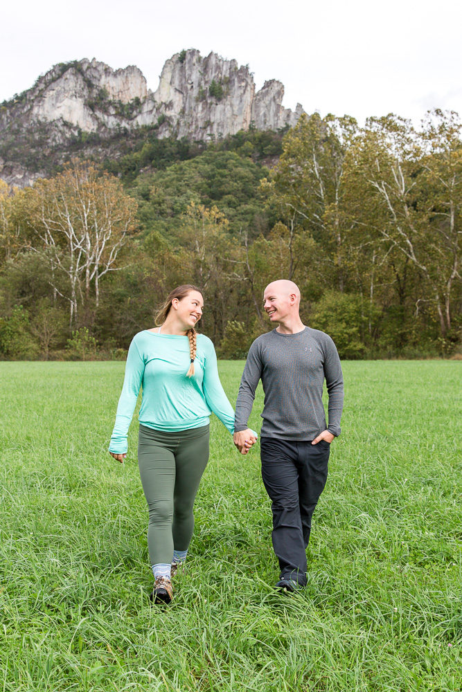Holding hands in the field before climbing Seneca Rocks