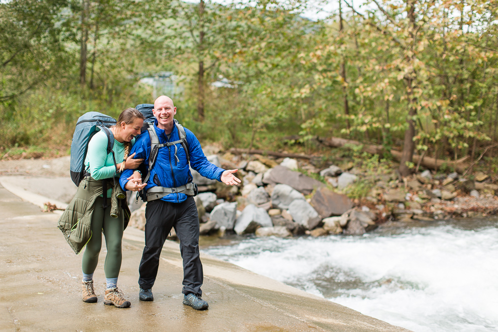 Fun, laughing photo during a backpacking and rock climbing engagement session | Best Northern Virginia candid engagement photography