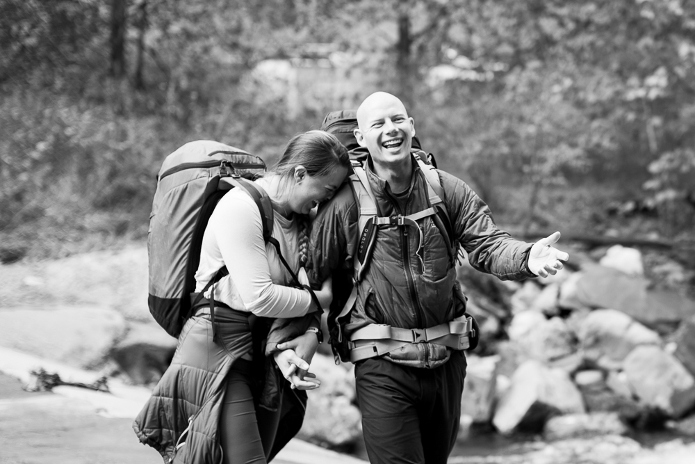 Candid, documentary style engagement pictures during a hiking session in the woods | Adventure photographer in Northern Virginia