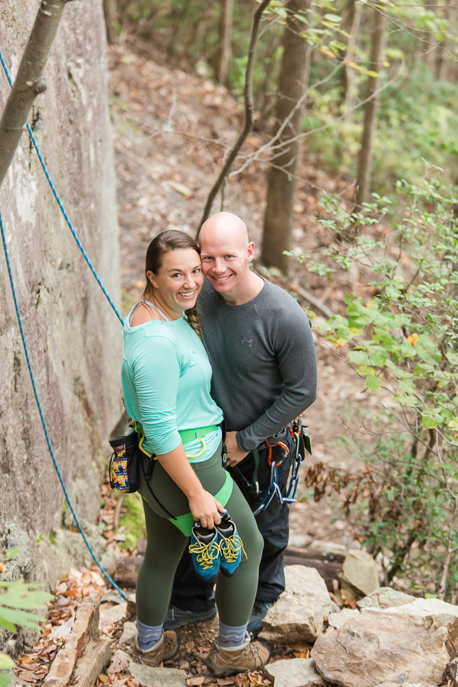 Engaged couple at the base of the crag, getting ready to rock climb