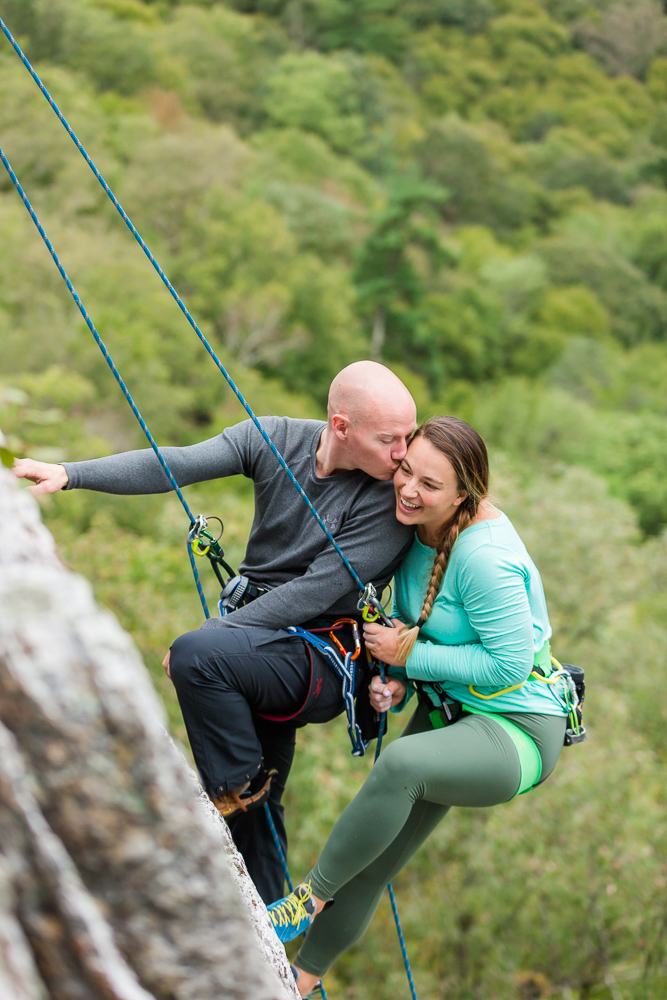 Giving his fiance a kiss on the cheek while rock climbing | Best Northern Virginia adventure photography