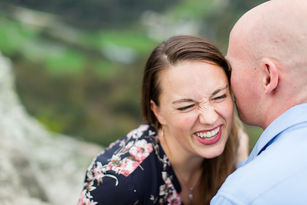 Laughing moment captured during engagement shoot in the mountains of West Virginia