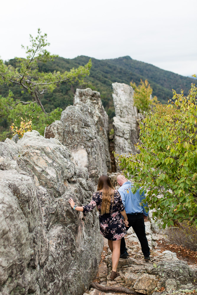 Walking through the rock walls at Seneca Rocks for adventure and rock climbing engagement pictures