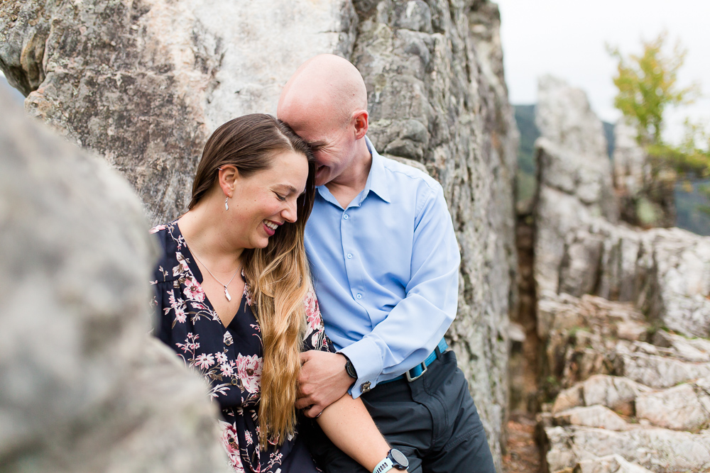 Sweet moment between the bride-to-be and her future husband during engagement pictures in the mountains at Seneca Rocks