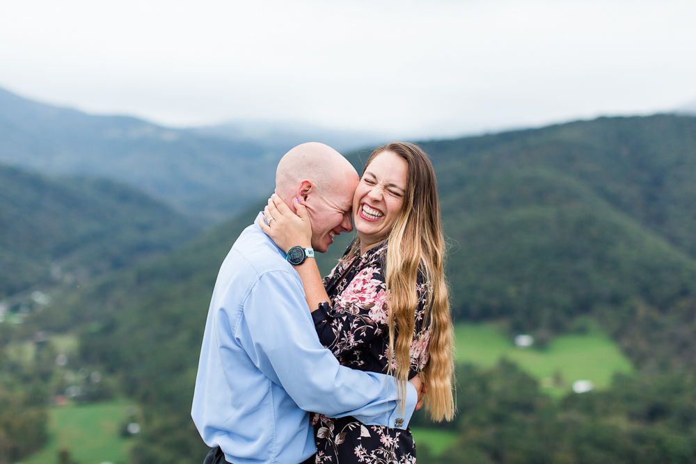 Fun and candid engagement picture from the top of Seneca Rocks | Fun Northern Virginia Engagement Photographer