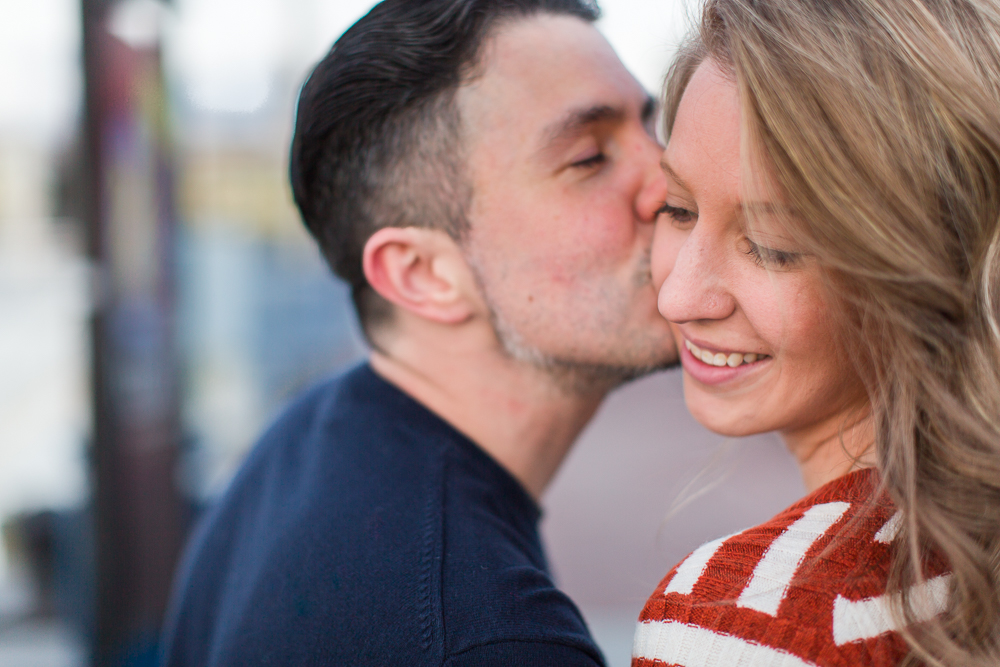 Romantic engagement picture kissing his fiancee on the cheek   Alexandria Engagement Photographer