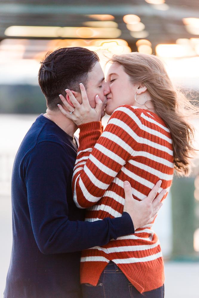 Kissing engagement photo at sunrise on the Potomac River   Alexandria Engagement Photography