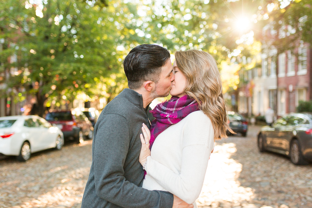 Engaged couple kisses in the middle of Prince Street in Old Town Alexandria   Cobblestone street engagement pictures in Alexandria, Virginia