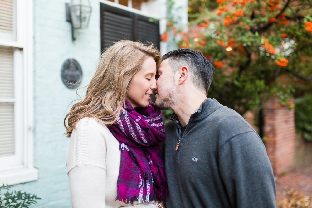 Happy couple leaning in for a kiss during an Alexandria, Virginia engagement shoot