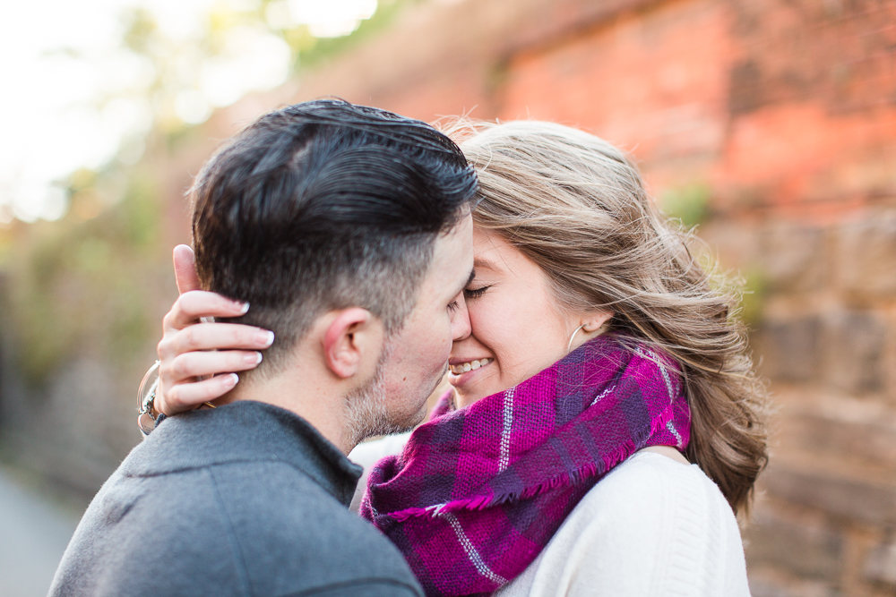 Romantic engagement picture as bride pulls groom in close   Old Town Alexandria engagement photography