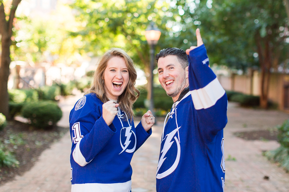 Fun engagement picture in their favorite hockey jerseys   Tampa Bay Lightning engagement photography
