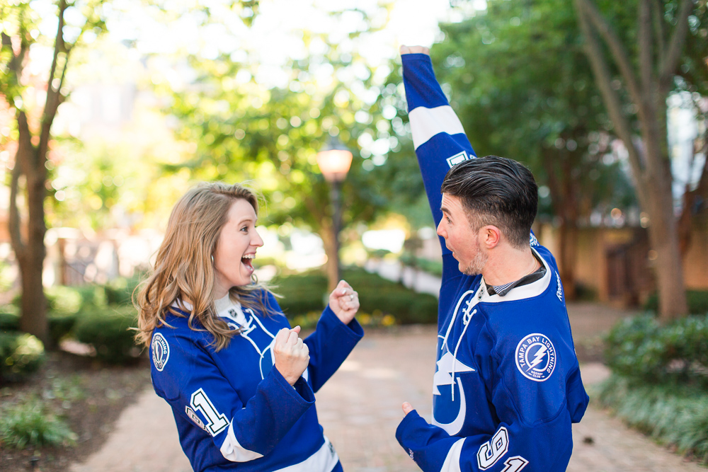 Tampa Bay Lighting fans having fun while wearing jerseys during their Alexandria engagement session