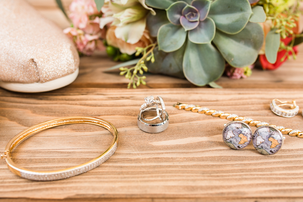 Wedding day details with jewelry and flowers