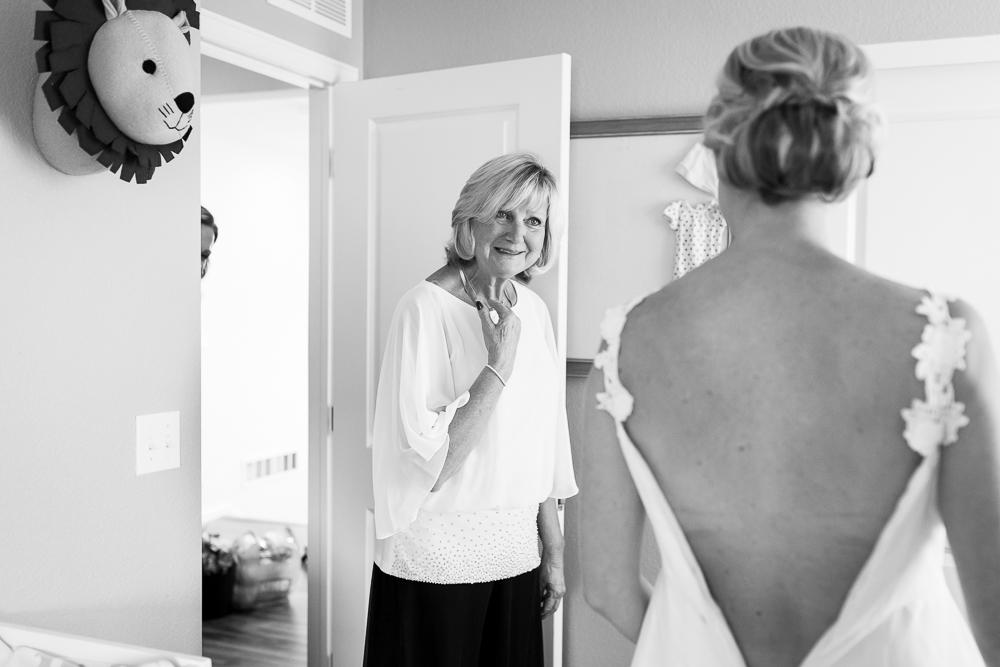 Surprised mom seeing bride in her altered wedding dress