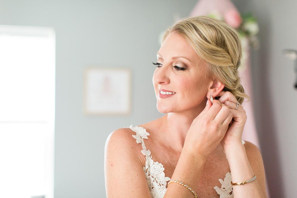 Denver bride putting on her earrings the morning of her wedding day | Denver wedding