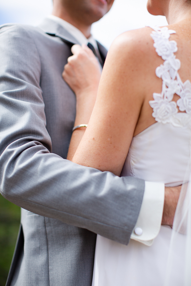 Close up photo of bride and groom holding each other