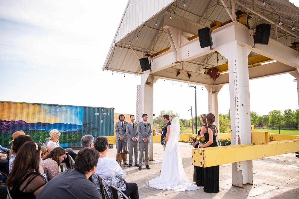 Outdoor wedding ceremony at The Hangar at Stanley Marketplace | Aurora, Colorado Wedding Photography